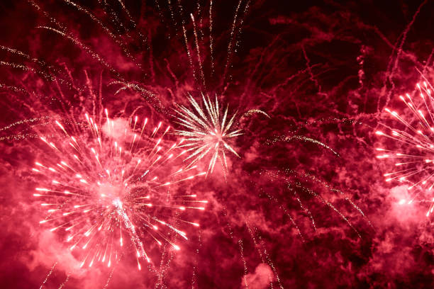 Explosions of red fireworks Explosions of red fireworks on the background on a dark night sky day 4 stock pictures, royalty-free photos & images