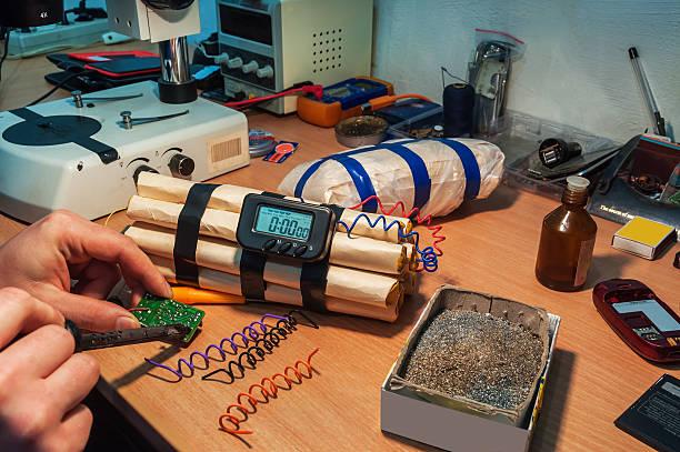 explosives maker in workshop explosives (timebomb) maker in workshop explosive stock pictures, royalty-free photos & images