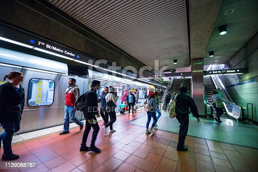 Los Angeles, USA - December 26, 2017: Expo Line Metro station from Santa Monica to Los Angeles, California, USA. People leaving the train in LA downtown