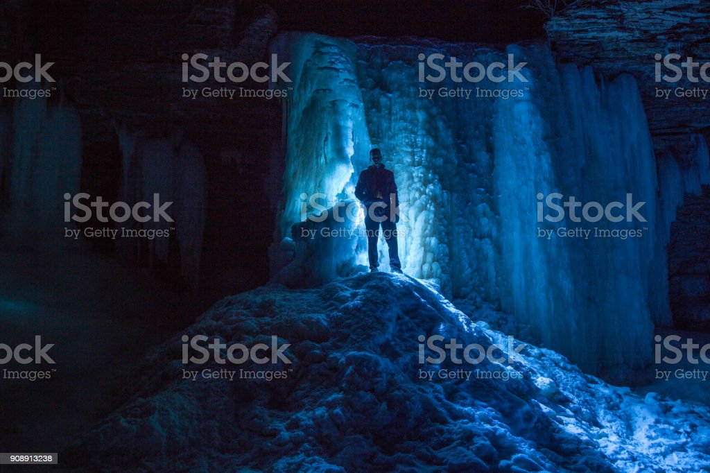 Exporing ice caves stock photo