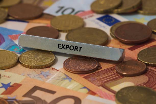 export - the word was printed on a metal bar. the metal bar was placed on several banknotes stock photo