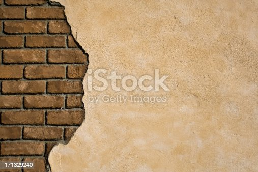 Stucco chipped off to reveal an exposed brick wall. Lots of copy space, this makes and outstanding background image.