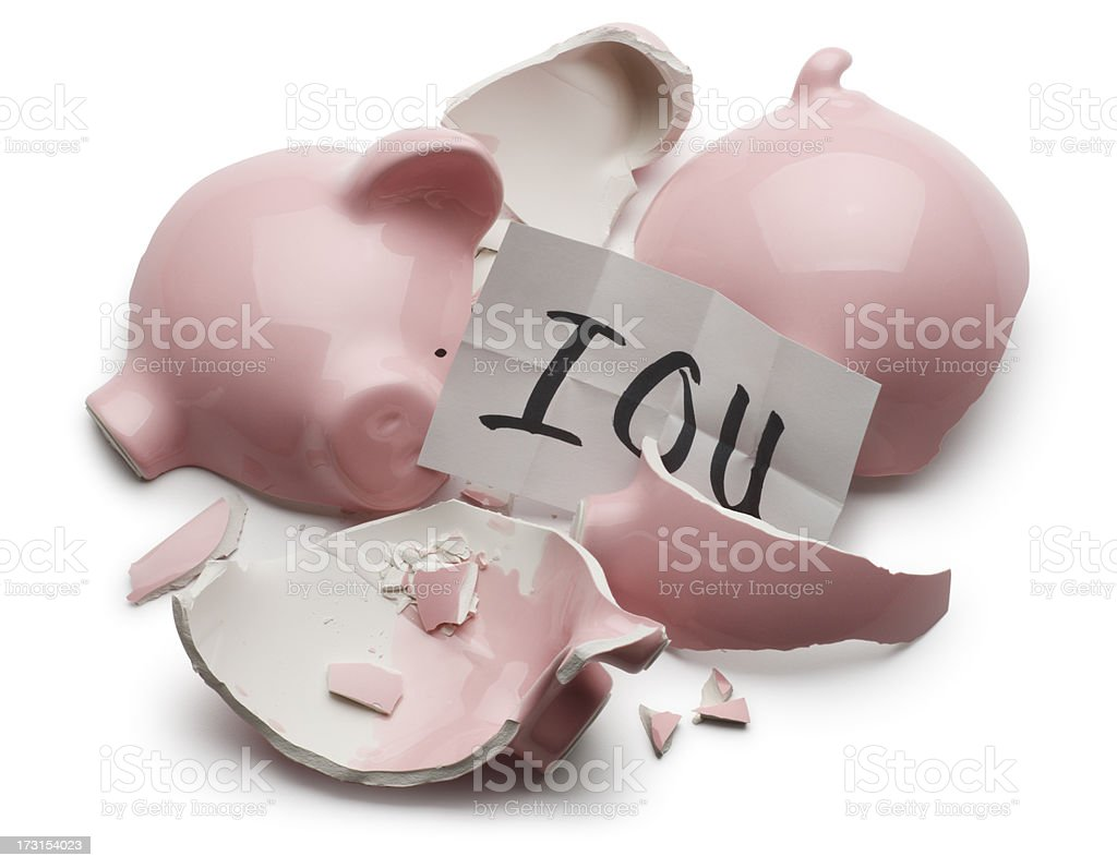 IOU exposed by broken pink piggy bank stock photo