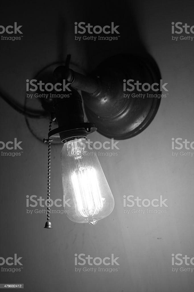 Exposed light bulb stock photo