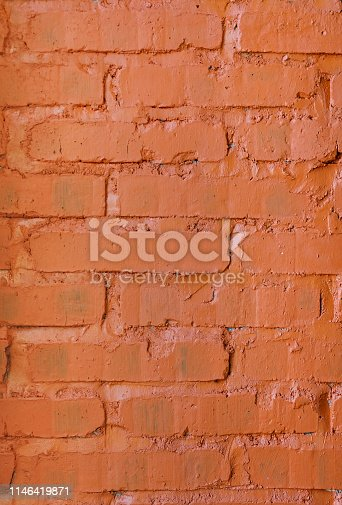 Close up exposed painted orange brick wall textured