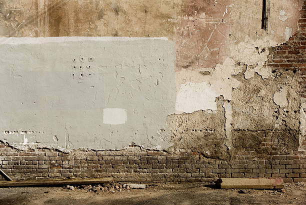 Exposing brick A distressed wall with brick exposed. alley stock pictures, royalty-free photos & images