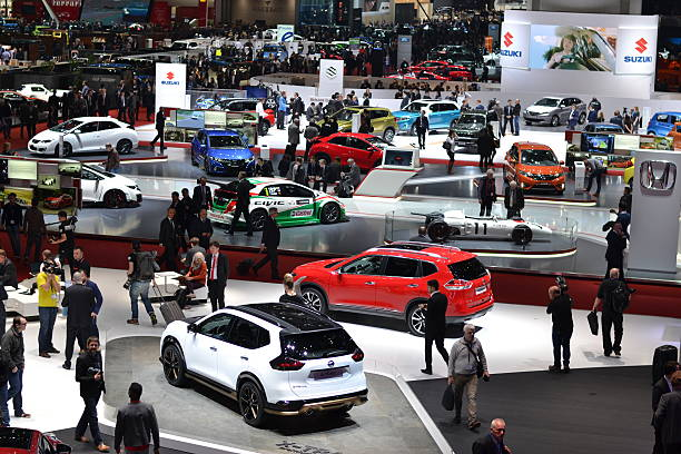 Exposition of modern cars on the motor show Geneva, Switzerland - March 1st, 2016: The visitors (especially journalists and businessmens) are looking on the new modern cars on the motor show. In a few days above thousands journalists saw the hundreds of vehicles. car show stock pictures, royalty-free photos & images