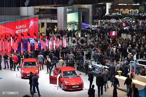 Geneva, Switzerland - March 1st, 2016: The visitors (especially journalists and businessmens) are looking on the new modern cars on the motor show. In a few days above thousands journalists saw the hundreds of vehicles.