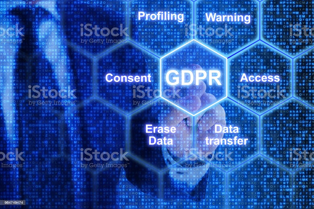 IT exppert touching a tile in a grid with GDPR keywords royalty-free stock photo