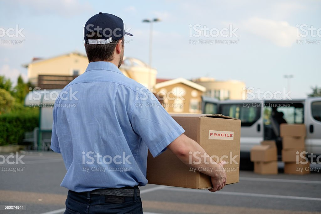 Express courier delivering a box stock photo