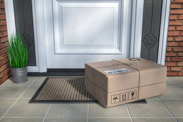 Express delivery, e-commerce online purchasing concept. Parcel box on floor near front door. stock photo