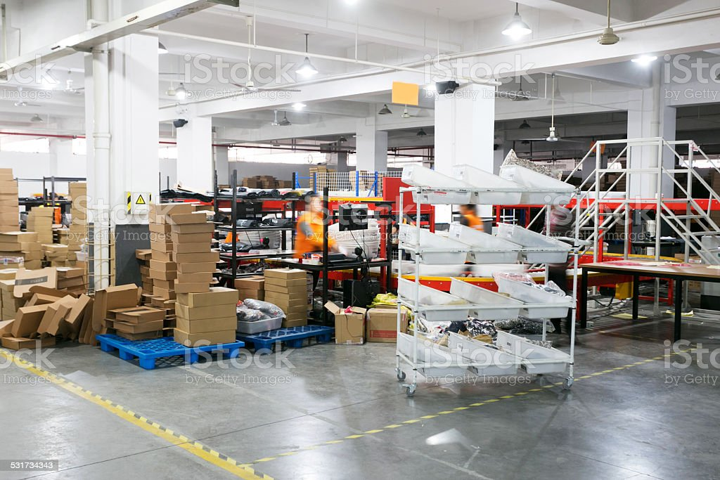 express delivery storage room interior in factory stock photo