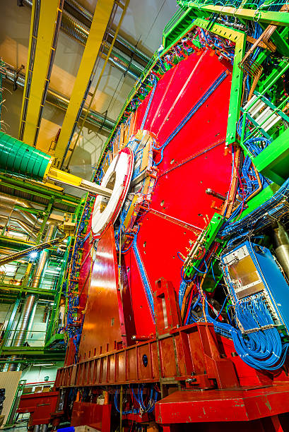 CMS Expriment Detector The 14,000 tonnes CMS detector, housed in a cathedral-like cavern, is an astounding feat of engineering and a symbol of large-scale international collaboration. large hadron collider stock pictures, royalty-free photos & images