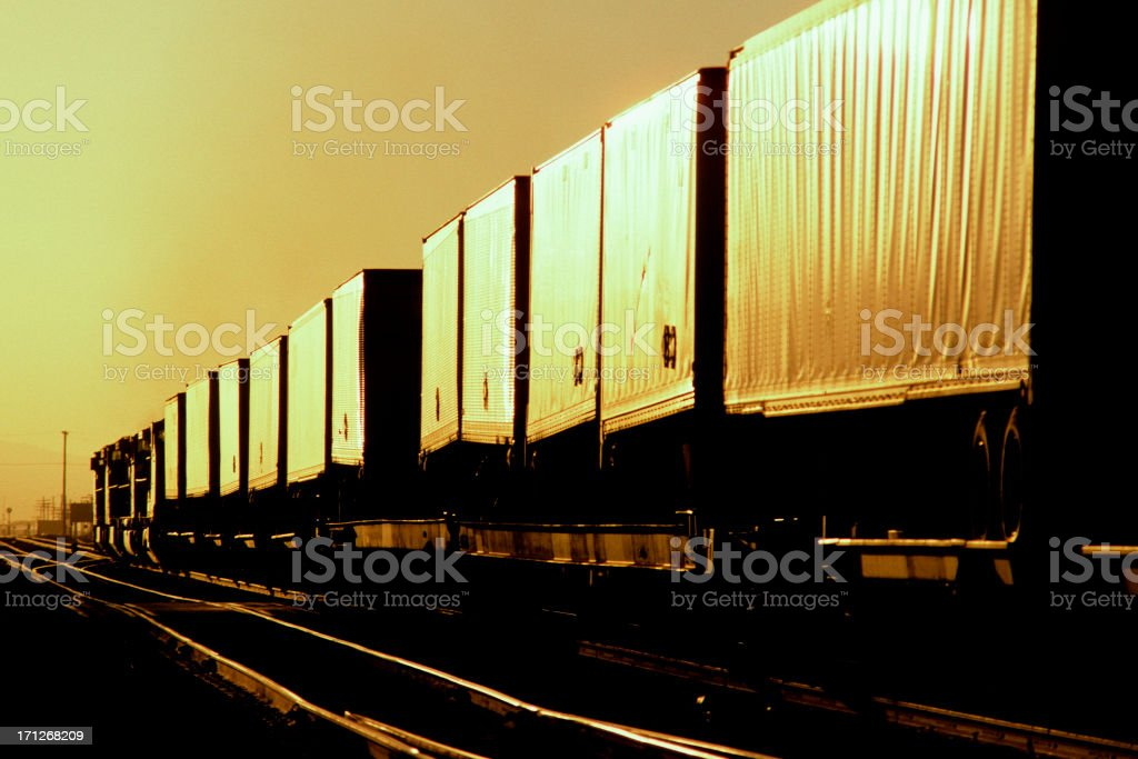 Express intermodal freight train heads into the sunset. stock photo