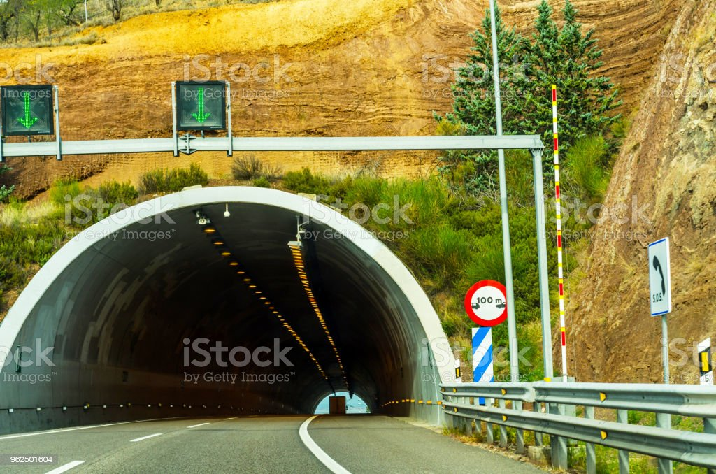 express road leading to the tunnel, the tunnel through the mountain - Royalty-free Adventure Stock Photo