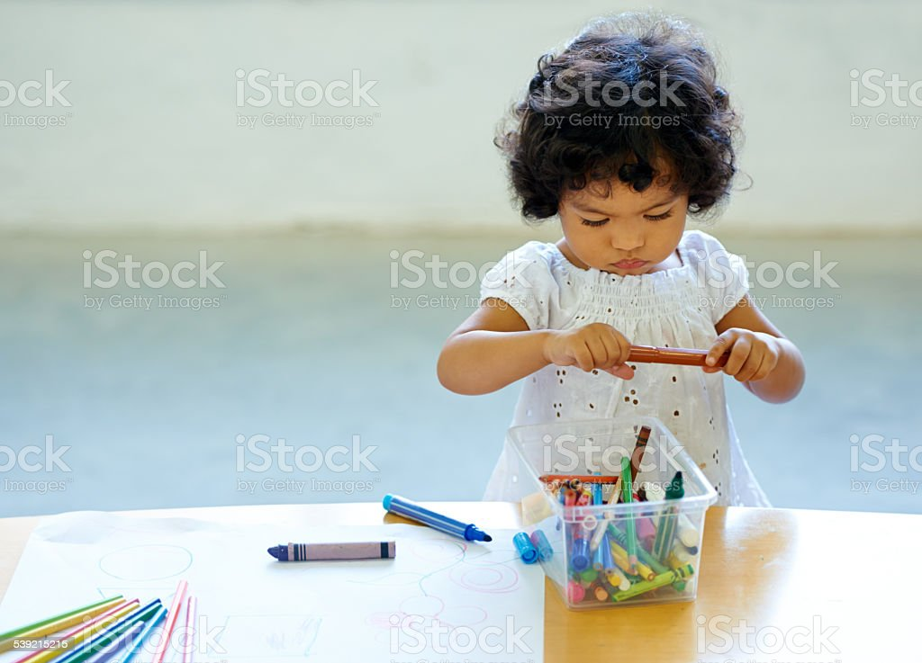 Expressing her creativity from a young age stock photo