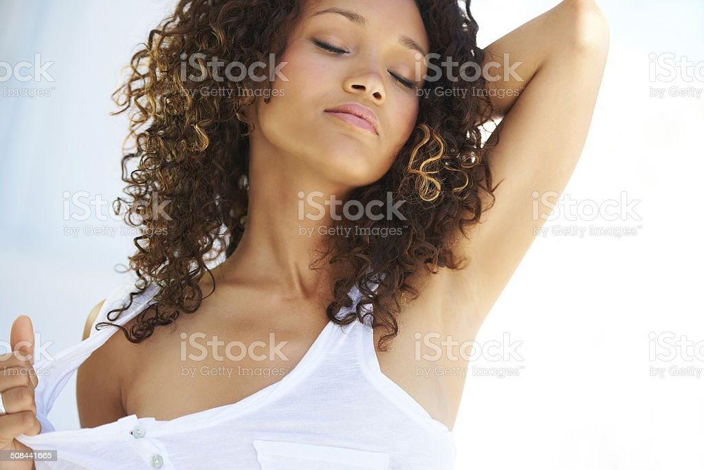 Expressing her sensuality stock photo