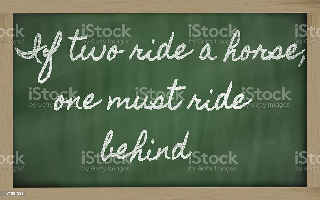 expression -  If two ride a horse one must behind royalty-free stock photo