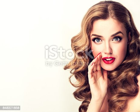 Lovely young woman is sharing fresh news with you. Brandnew gossip. Pin-up style make up, and red manicure. Wispering lady.