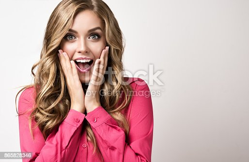 istock Expression of shock and excitement on the face of young businesswoman. 865828346