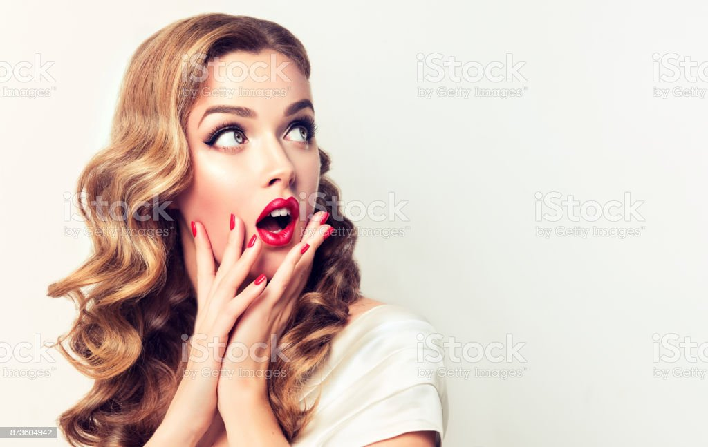Expression of shock and excitement on the face of young woman.Blonde in shock. royalty-free stock photo