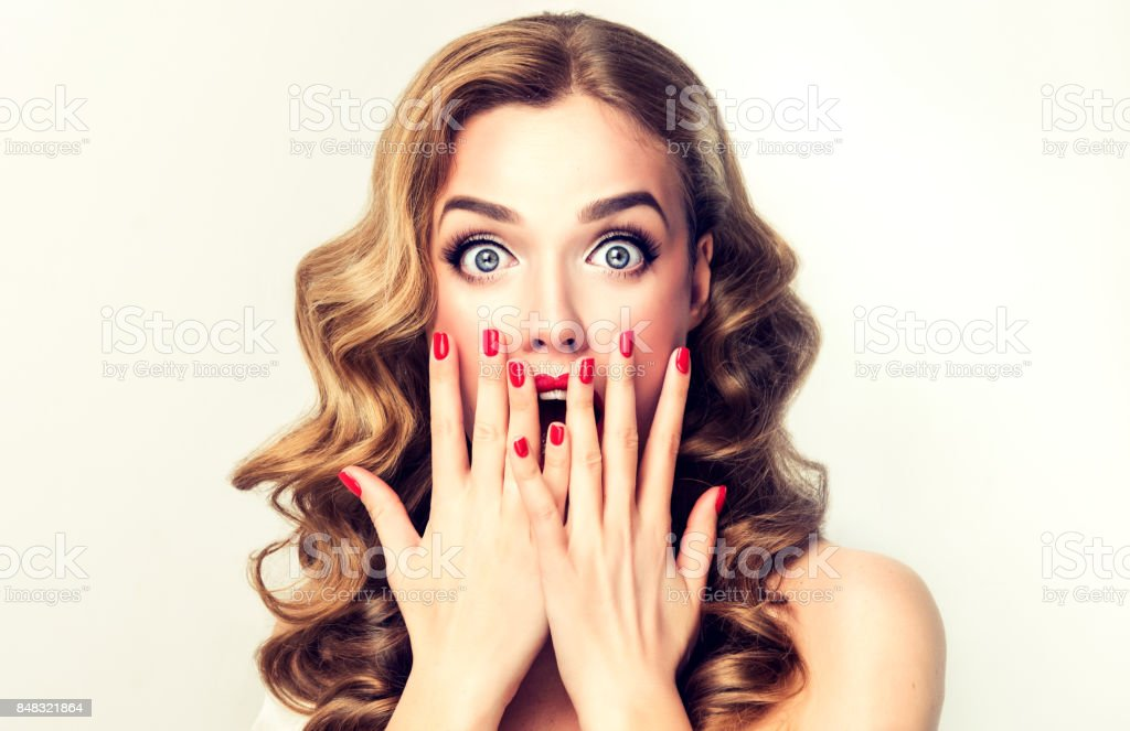 Expression of shock on the face of young woman. stock photo