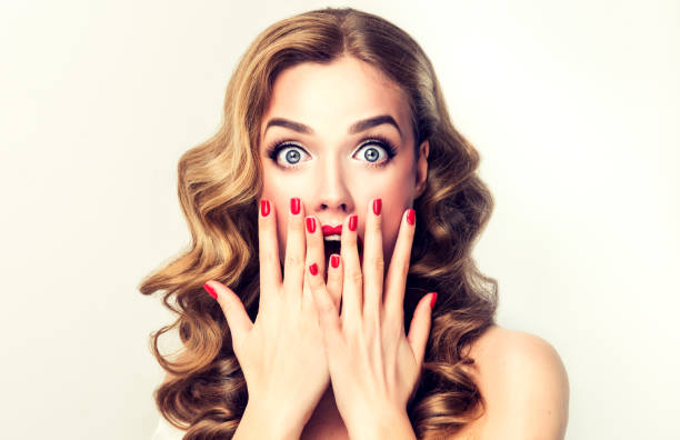 expression of shock on the face of young woman. - astonishment stock photos and pictures