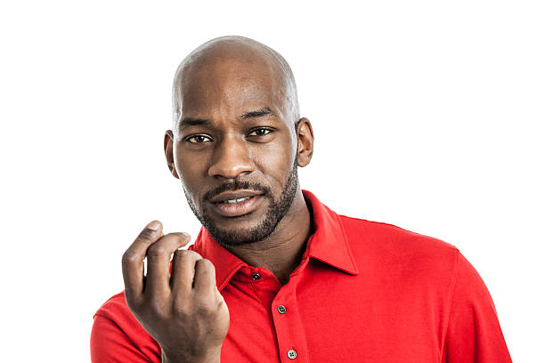 Expressive black man portrait Portrait of a handsome late 20s black man with show me the money expression isolated on white background snapping stock pictures, royalty-free photos & images