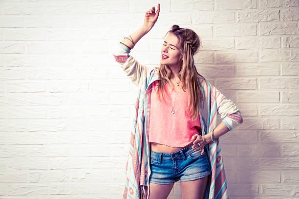 Expressive Boho Fashion Girl Singing and Dancing stock photo