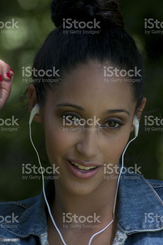 Expressive Girl Listening To Headphones royalty-free stock photo