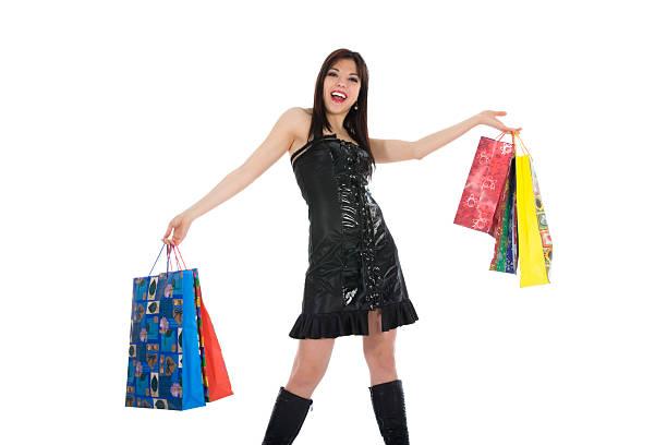 ausdrucksstarke frau shopping - geld schön verpacken stock-fotos und bilder
