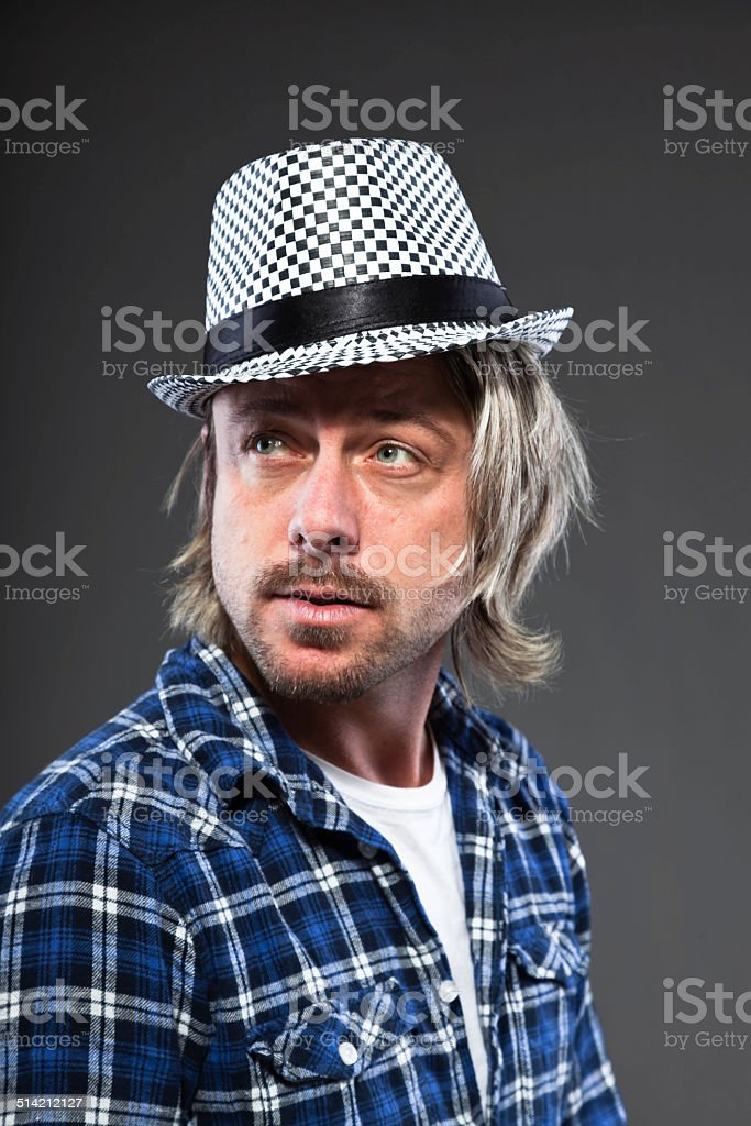Expressive Young Man With Blond Long Hair And Ska Hat Stock Photo Download Image Now Istock