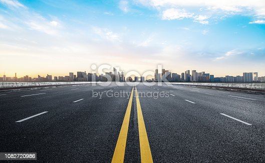 istock Expressway and Modern Urban Architecture in Qiantang River New Town, Hangzhou, China 1082720986