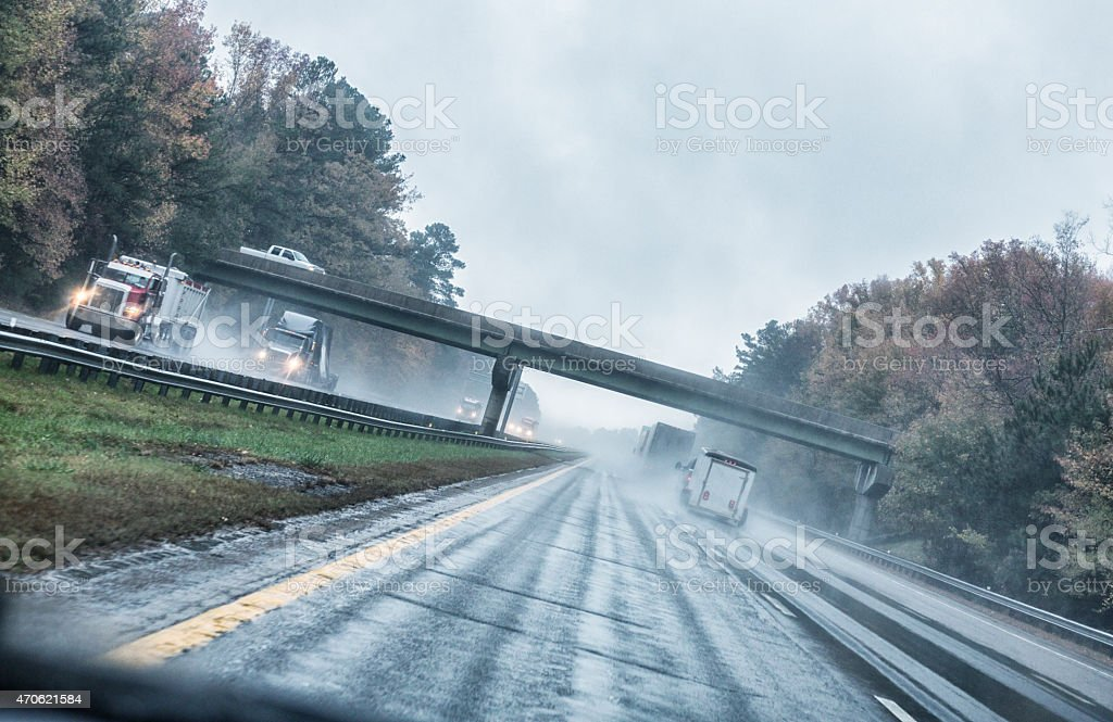 Expressway Driving Commercial Truck Traffic During Heavy Rain Storm stock photo