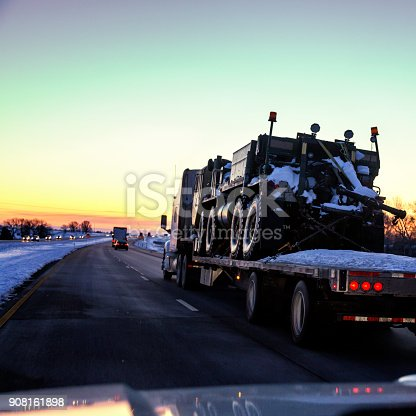 istock Expressway Flatbed Semi Truck Hauling Armored Military Land Vehicle 908161898
