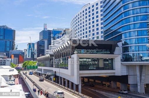 Sydney, Australia - November 25, 2016: Pedestrians walking past the newly refurbished and expanded Hyatt Regency hotel built over the expressway road beside Darling Harbour in Sydney