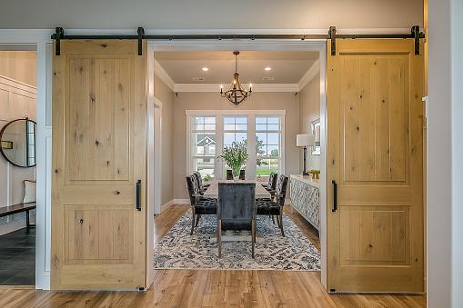 Beautiful wood barn doors and hardwood flooring give an elegant but down to earth type of feel