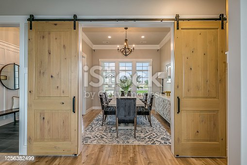 Beautiful wood barn doors and hardwood flooring give an elegant but down to earth type of feel