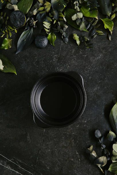exquisite serving black bowl template on natural dark stone - alta moda italy foto e immagini stock