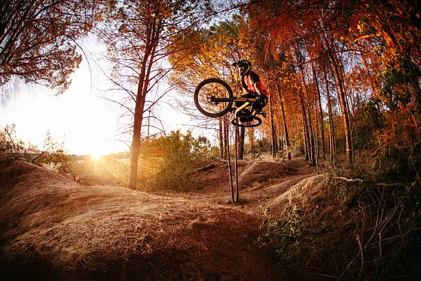exteme mountain biker performing aerial maneuvers while dirt jum - mountain bike stock pictures, royalty-free photos & images