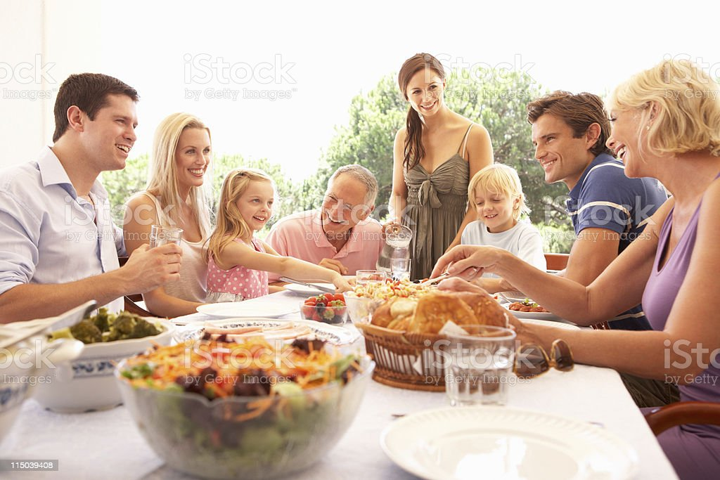 Extended family enjoying picnic stock photo