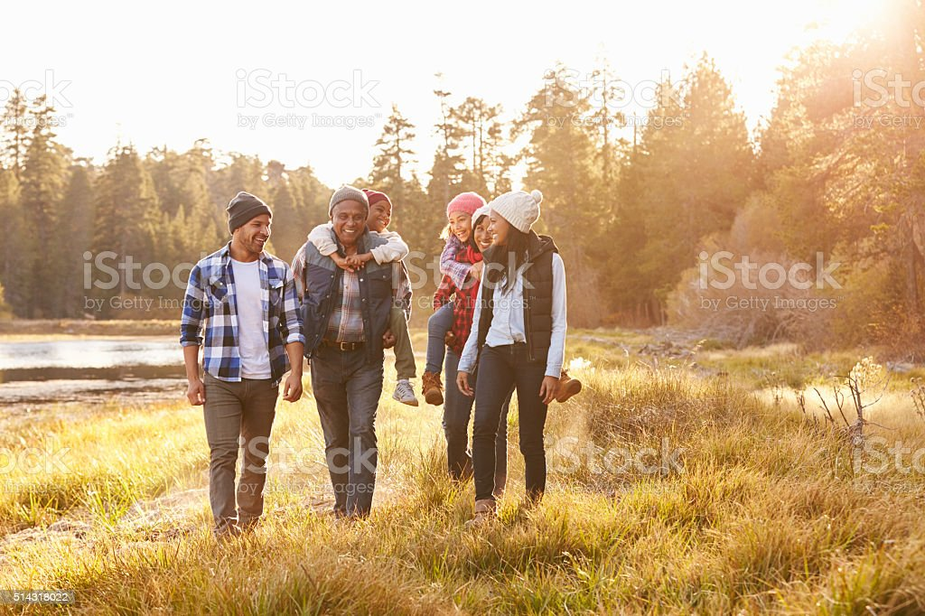 Extended Family Group Walking By Lake stock photo