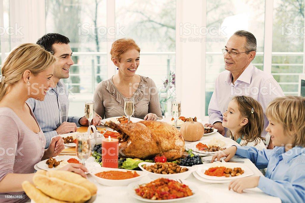 Extended Family Having Thanksgiving Dinner. Stock Photo