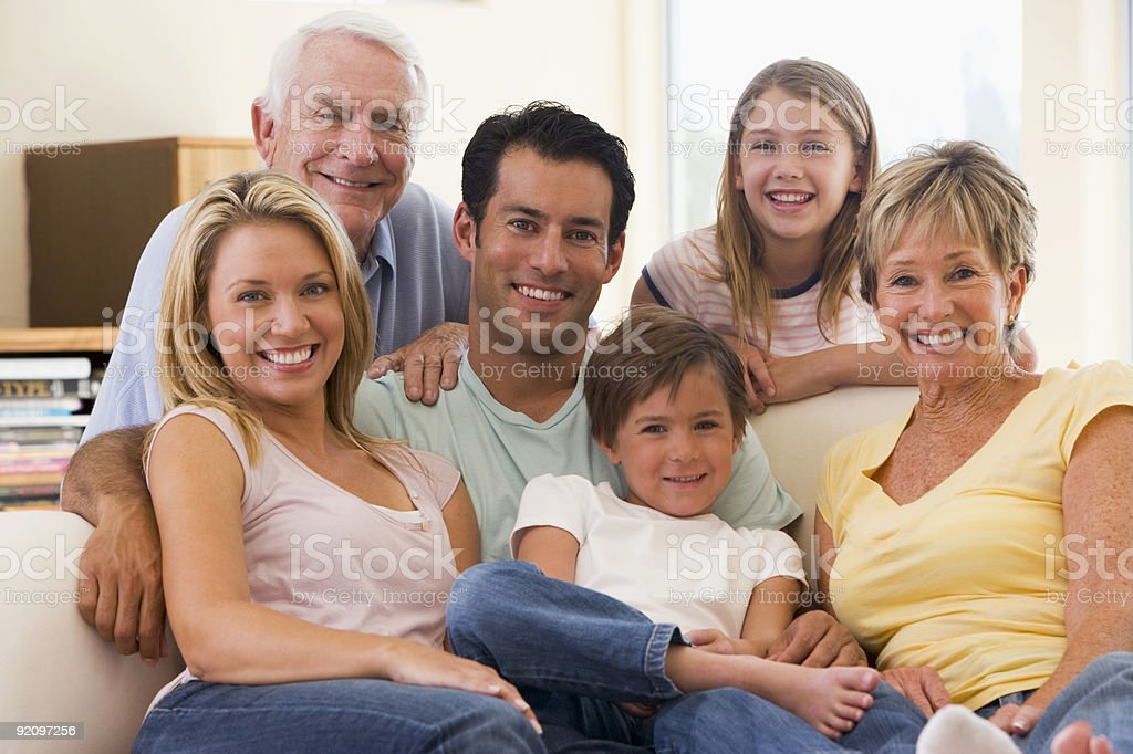 Extended family in living room smiling  30-39 Years Stock Photo