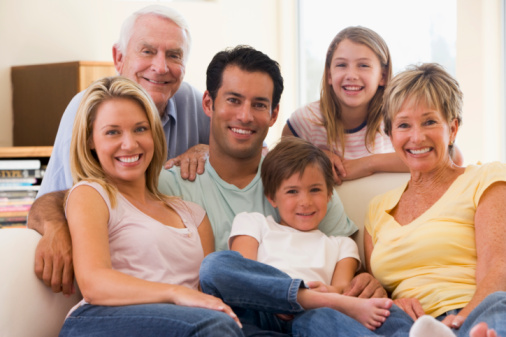 Extended Family In Living Room Smiling Stock Photo - Download Image Now