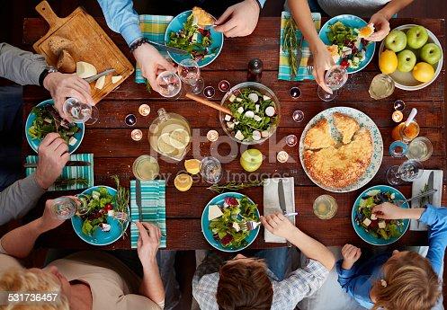 Multi-generation family having a delicious dinner