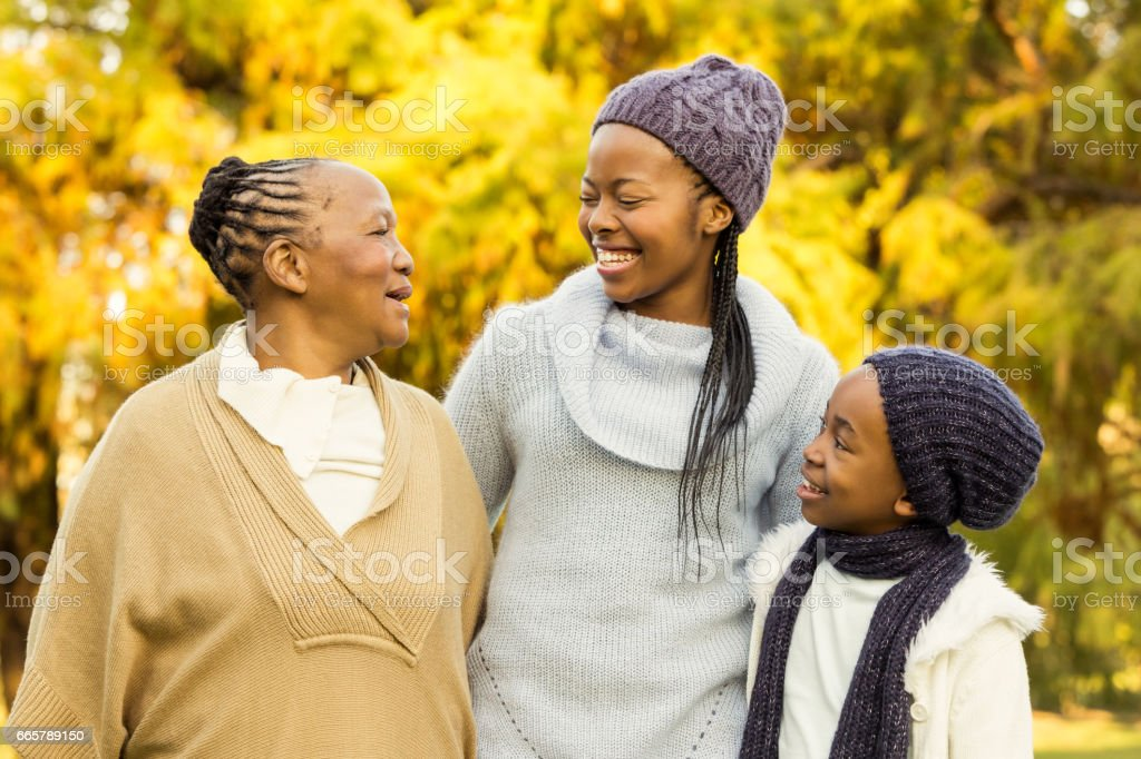 Extended family posing with warm clothes stock photo