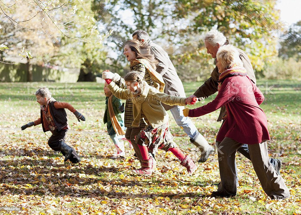 Extended family running in park royalty-free stock photo