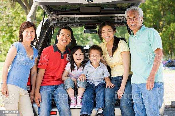 Extended Family Sitting In Tailgate Of Car Stock Photo - Download Image Now