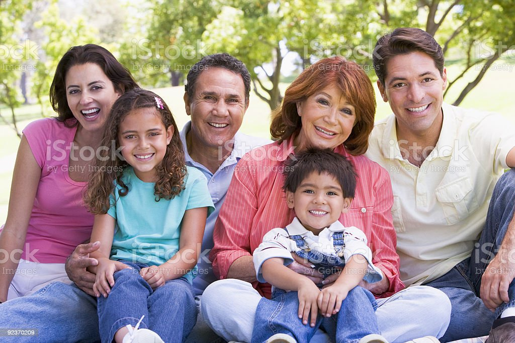 Extended family sitting outdoors royalty-free stock photo